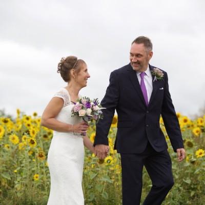 Lifton Strawberry Fields, Lifton, Devon. Flowers by Flower Scene. Dress from Lowen Bridal. September.